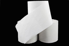 Stack of toilet paper on black Stock Image