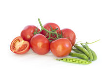 Stack of tomatoes  and peas Royalty Free Stock Photos