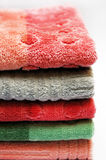 Stack of towels. Bath towels of different colours piled on top of one another Royalty Free Stock Photography