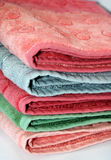 Stack of towels. Bath towels of different colours piled on top of one another Stock Photos