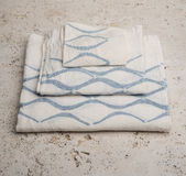 Stack of Towels with Blue Concave Lines at High Angle Royalty Free Stock Image