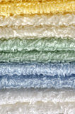 Stack of towels close-up. This photo shows a stack of different color towels close-up Royalty Free Stock Images