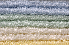 Stack of towels close-up. This photo shows a stack of different color towels close-up Royalty Free Stock Photo