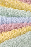 Stack of towels close-up. This photo shows a stack of different color towels close-up Royalty Free Stock Photos