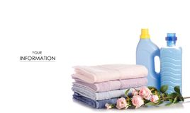 A stack of towels flower softener conditioner liquid laundry detergent pattern. On white background isolation stock photo