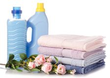 A stack of towels flower softener conditioner liquid laundry detergent. On white background isolation Stock Images
