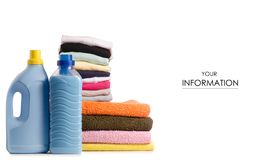 A stack of towels and launder a bottle of liquid powder pattern. On a white background isolation royalty free stock photo