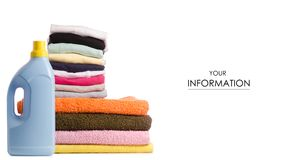 A stack of towels and launder a bottle of liquid powder pattern. On a white background isolation royalty free stock photography