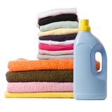A stack of towels and launder a bottle of liquid powder. On a white background isolation Stock Photos