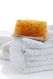 Stack of towels and natural soap bar Royalty Free Stock Images