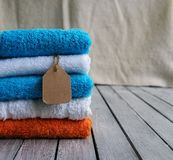 Stack of towels with a price tag Stock Photography