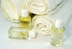 Stack of towels with skin oils Royalty Free Stock Image