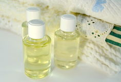 Stack of towels with skin oils Royalty Free Stock Images