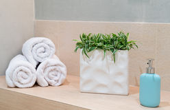 Stack of towels with a soap dispenser in a bathroom Stock Image