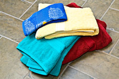 Stack of Towels/Tile Floor Royalty Free Stock Photos
