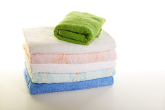Stack of towels on a white background royalty free stock image