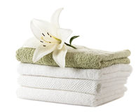 Stack of towels with white lily Royalty Free Stock Images