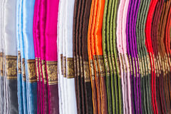 stack of traditional colourful sarong in the shop. for a backgro Stock Photography