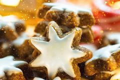 Stack of Traditional German Christmas Cookies Home Baked Glazed Cinnamon Stars Sparkling Garland Lights Candle Candy Canes Festive. Magic Atmosphere Stock Image