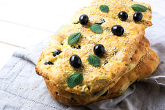 Stack of traditional Italian bread focaccia with olive, garlic a royalty free stock image