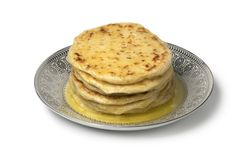Stack of traditional Moroccan meloui pancakes topped with butter stock images