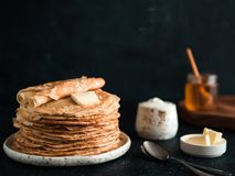 Russian pancakes blini on black with copy space stock images