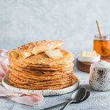 Russian pancakes blini with copy space. Stack of traditional russian pancakes blini on gray background with copy space. Homemade russian thin pancakes blini royalty free stock photography