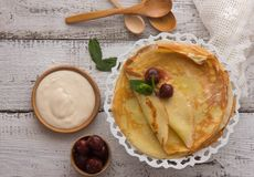 Stack of traditional russian pancakes blini on gray background with copy space. Homemade russian thin pancakes blini. Russian food stock images