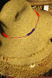 Stack of traditional straw hats. On open air market stand stock photos