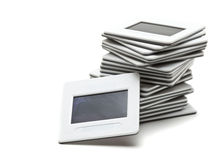 Stack of transparency slides. Over white background Royalty Free Stock Image