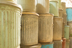 Stack of trash cans in color Stock Photos