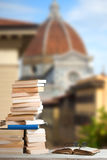 Stack of Travel Guides before the famos Duomo in Florence Royalty Free Stock Image