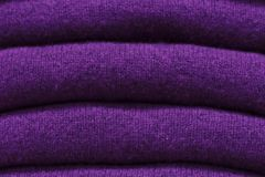 Stack of trend Ultra Violet woolen sweaters close-up, texture, background royalty free stock images