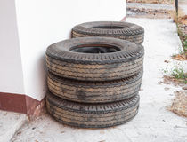 Stack of Truck Tyres on Concrete Ground Stock Photo