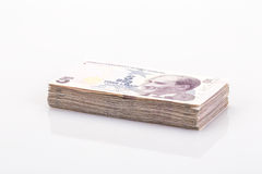 Stack of turkish liras on white Royalty Free Stock Photos