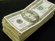 Stack of Twenty Dollar Bills. Stack of cold hard cash.  Big stack of circulated US twenty dollar bills.  Good wealth, finance, or inspirational picture Royalty Free Stock Image