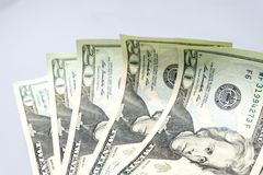 Stack of twenty dollar bills on white background. royalty free stock photography