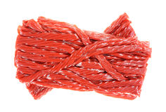 Stack Twisted Cherry Licorice Sticks On White Royalty Free Stock Photography