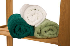 Stack of twisted terry towels on a shelf Royalty Free Stock Images