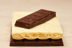 Stack of two black and one white chocolate closeup Stock Photography