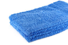 Stack of two blue towels. On white Royalty Free Stock Photography