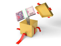 The stack of ukrainian money jumps out of a gift box on a spring Royalty Free Stock Image