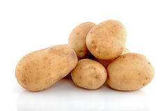 Stack of unpeeled potatoes Royalty Free Stock Image