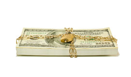 Stack of US 100 dollar bills chained and locked Stock Images
