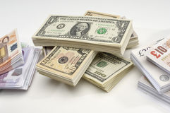 Stack of US, British and European Currency Stock Images