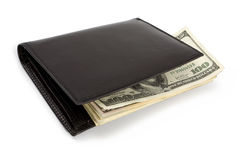 Stack of US currency in wallet. Stack of dollar banknotes in black wallet isolated on white. Clipping path incl royalty free stock photo