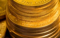 Stack of US Treasury Gold Eagle one ounce coins stock image