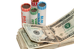 Stack of USA Currency and Rolls of Coins Stock Image