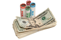 Stack of USA Currency and Rolls of Coins Stock Images