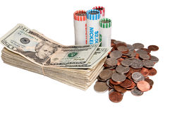 Stack of USA Currency and Rolls of Coins Stock Photography